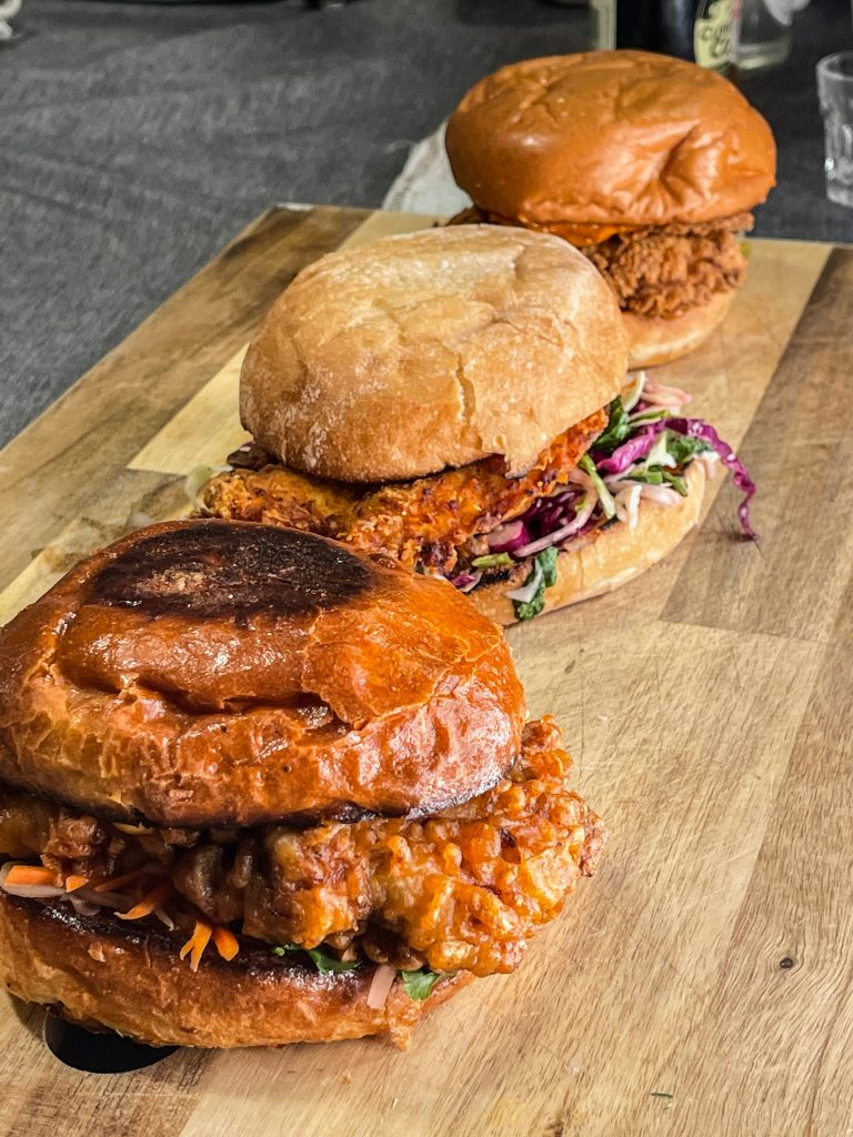 Fried chicken sandwiches on a cutting board